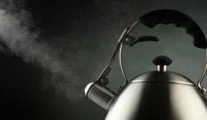 Tea kettle with boiling water
