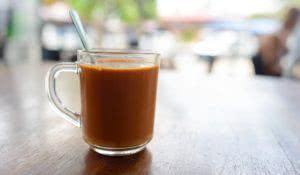 close up shot of black tea with milk